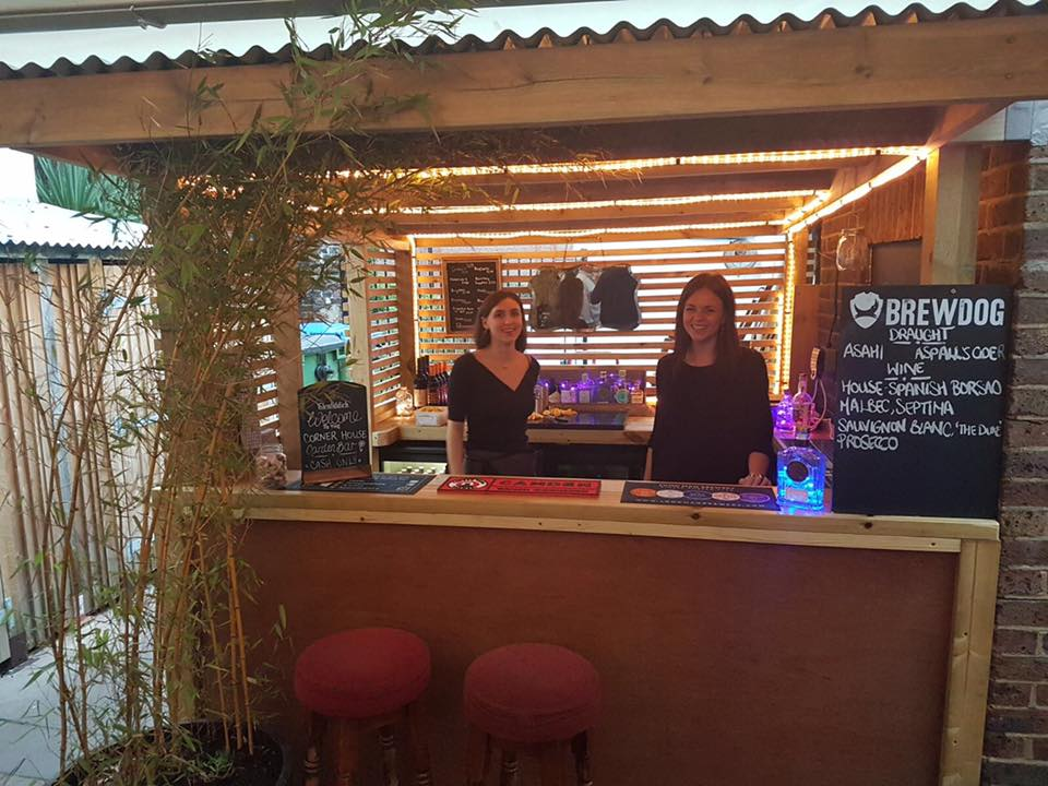 The corner house opens a garden gin bar in worthing for Garden shed gin